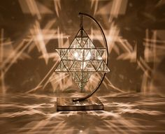 The Geometric Luminary collection of ZakayGlass Creations is infused with a deep appreciation for nature's gift of the golden ratio. Each piece is created with the idea that the home is a sacred place and should be occupied by objects that enhance and enrich the space and its inhabitants. Here is Ariel Luminary, based on the star tetrahedron suspnded in a specially designed New Moon stand. www.liberatingdivineconsciousness.com