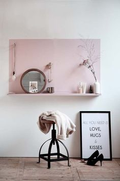 Paint a color block and a shelf to match for a simple, defined space to serve a function.