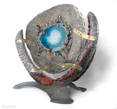 "Eye of Ta'roq by Wendy Edsall-Kerwin nickel, copper, brass, agate ~ 8.5""h x 9.5""w"