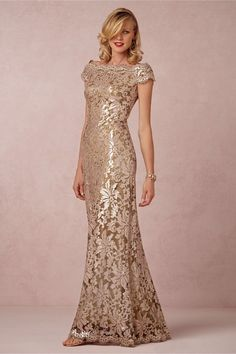 This sequined boatneck creation from Tadashi Shoji blends glamour with a bit of vintage flair. Its lace overlay is studded with hundreds of matte sequins arranged in a stunning blooming pattern.