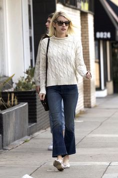 Emma Roberts proves the classic fisherman sweater and cropped jeans are a no-fail pairing.
