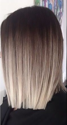 For a shorter but more striking ombre look, this style has it all. Starting with a rich, dark brown shade, the color blends into an icy, platinum blonde at the tips in a short amount of space. The transition is smooth with a bit of dirty blonde in the mix. The look is striking and edgy while still pulling in that natural look that goes well with any season of the year. This look is ideal for short hair styles.