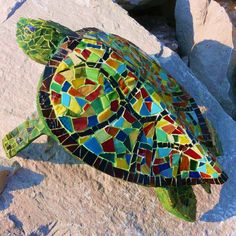 Stained glass mosaic turtle made from a palm frond.