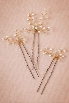 These gold and pearl hair pins are simple accessories for a mother of the bride or bride who chooses to wear an updo.