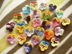 Beautiful crocheted pansies! I especially love the ones with multi-colored yarn.