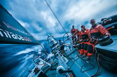 April 22, 2015. Leg 6 to Newport onboard Team Alvimedica. Day 03. Dave Swete, Alberto Bolzan, Mark Towill, and Charlie Enright sit in the cockpit as night approaches, shielded by the sail stack during naggingly wet upwind sailing conditions. Conditions remain largely the same for the third consecutive day of upwind sailing east and away from a chasing cold front Amory Ross / Team Alvimedica / Volvo Ocean Race