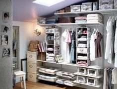 A storage space with ALGOT shelves, baskets and clothes rails