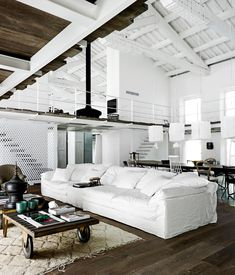 An industrial style renovation has been carried out by designer Paola Navone