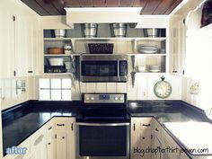 Beautiful white kitchen makeover on betterafter.net with painted paneling.
