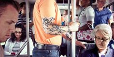 A man with tattoos on his arms