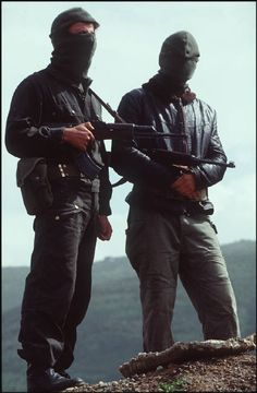 Algeria - Great Kabylie. Village of Makouba. On the left is a Ninja (gendarme) with a Kalashnikov, on the right a member of the Comite De Vigilance militia