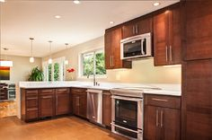 Floor color and counter top color would look good in our kitchen - also like the knobs/handles Floor Colors, Knobs And Handles, Counter Top, Modern Contemporary, Top Colour, Kitchen Cabinets, Fan, Flooring, Photos