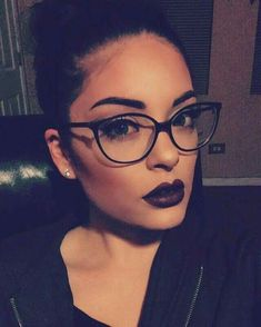 Glasses and her makeup is amazing