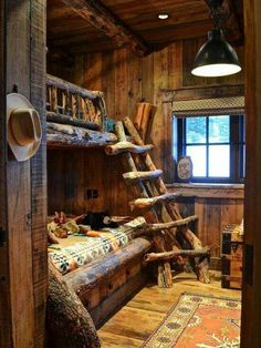 Sleeping bunked style in a log cabin guest room.