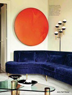 Indigo Blue couch set of with an Orange piece of artwork