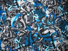Blue graffiti tattoo swatch. We have used this fabric for our crutch pads, hand grips and crutch bags. Crutcheze can also do special requests, such as, walker bags and skins.