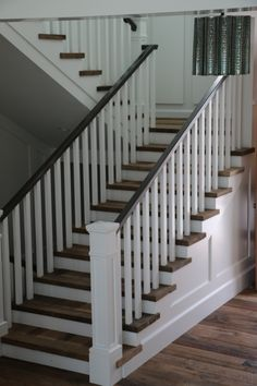 reclaimed wood staircase + white stair railing + stairway
