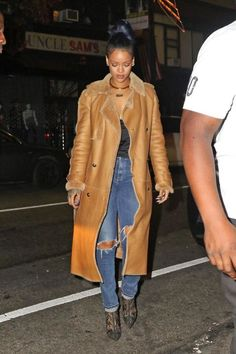 It doesn't get cozier, or chicer than a richly colored ankle length shearling coat. Rihanna keeps hers casual with a black tank and shredded jeans.