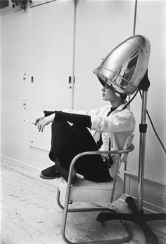Iconic image of the quest for beauty...Audrey Hepburn drying her hair. The glamorous way.