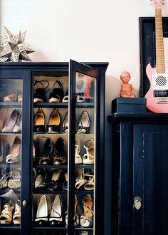 Love the shoes in a vintage cabinet...