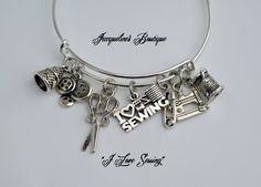 Do you know someone who Loves to sew? If you do, this is the Perfect Gift to give.  This expandable bangle bracelet comes with these silver charms, a thimble, buttons, scissors, I ♥ Sewing, safety-pin, sewing machine and a spool of thread.  Charms are ...
