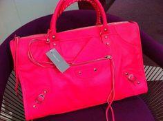 Neon pink Balenciaga bag