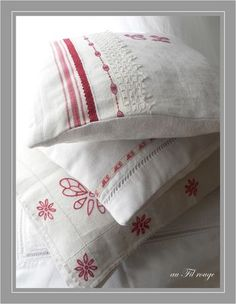 embellished linen pillows. redwork.