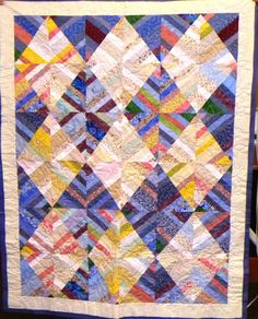 Love the big string blocks turned into diamonds! Quilted by Mary Tennant.
