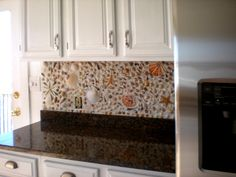 Shell backsplash. Try it in the kitchen. Too expected in the bathroom.