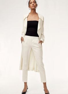 Babaton's cropped, slim fit dress pants are highly versatile and universally flattering. These ones are made with TeradoTM, a Japanese fabric that's matte crepe on one side and satin on the other. White Dress Pants, Slim Fit Dress Pants, Japanese Fabric, Black Blouse, Work Fashion, White Jeans, Joggers, Pants For Women, Trousers