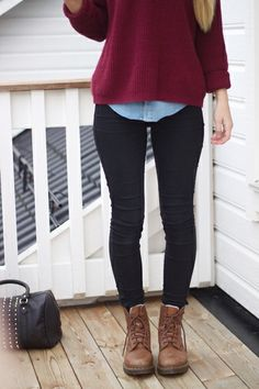 layers under a nice maroon sweater and brown combat boots .