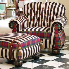 The bold stripes of the Campaign Club Chair and Ottoman.