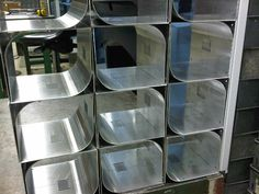 Aluminium top covers with curves formed by multi-bending sheet metal with small steps.