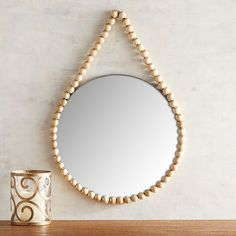 """Mirrors - Eclectic and unforgettable. Wearing a """"necklace"""" of wooden beads, our round mirror brings an element of boho style just about anywhere—in the entryway for a . Beaded Mirror, Diy Mirror, Wall Mirror, Vanity Mirrors, Wooden Bead Necklaces, Wooden Beads, Mirror Inspiration, Leaf Wall Art, Sunburst Mirror"""