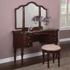 bedroom vanity with mirror and bench