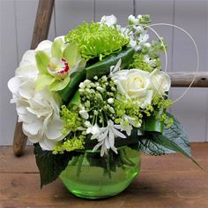 Emerald Globe The Green Room Florist Roundwood Funeral Flowers, Wedding Flowers, Glass Globe, Glass Vase, Flower Boutique, Cymbidium Orchids, Agapanthus, Seasonal Flowers, Green Rooms