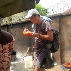 Chinese Guy Eats Hungrily On Abuja Streets - Food - Nigeria