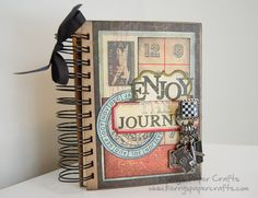 Mini album--uses envelopes as pages with journaling cards in the envelopes. Detailed pictures.