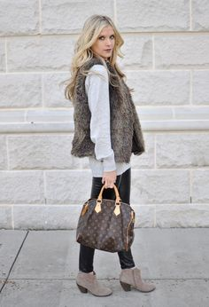 For an effortless winter look, wear a fur vest over a silky white blouse. Pair the combo back to booties for a casual spin.