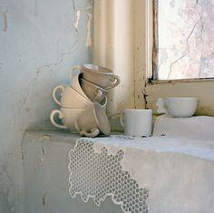 Cups on window sill