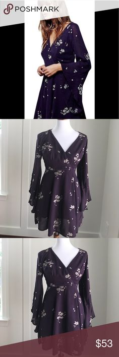 Free People Jasmine Dress Size 4 Sweet floral embroidery punctuates the soft silhouette of a romantic wrap-front dress featuring flouncy angel sleeves and a gently flowing skirt. - Surplice neck - Long sleeves - Lined Free People Dresses