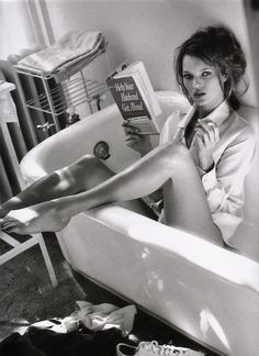 kate moss reading..and smoking...
