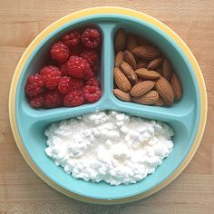 Light lunch/snack. Low fat cottage cheese with almonds and raspberries :) Looks good. I want tupperware like that.