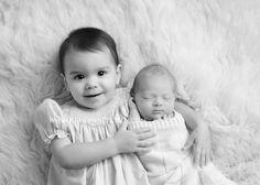 Newborn with toddler sibling. Black & white studio portrait. Keri Lynn Photography | Baton Rouge, Louisiana Newborn Photographer
