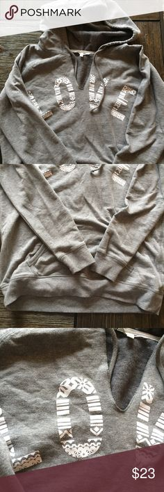 NEW LISTING! - VS Holiday Pullover Sweatshirt NWOT Grey holiday pullover sweatshirt from Victoria's Secret. Super comfortable fleece material on the inside. Size Large. Never worn! Victoria's Secret Tops Sweatshirts & Hoodies