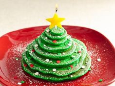 Christmas Tree Stack Pancakes Recipe from Betty Crocker.  *LOVE the star candle on top.