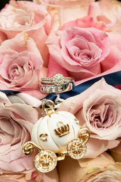 Kristin's wedding rings and Cinderella pumpkin coach charm in her Disney Memories wedding bridal bouquet
