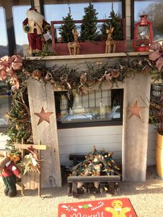 Faux winter fireplace. Pine garland, white lights, homespun bows, pine cones and alpine trees add to the beauty of this Christmas vignette. Drift wood with flicker lights in the fireplace makes it warm and cozy on those cold winter nights.