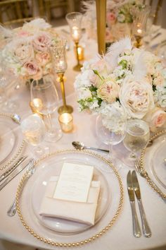Love this look? We can help you re-create it with gold beaded glass chargers, modern white china plates, white satin napkins, silverware, and beautiful glass stemware. Such a gorgeous table design for an elegant white, blush, and gold wedding!
