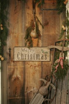 I LOVE this prim decorated old door! Maybe I could do this with my barn door for my porch??
